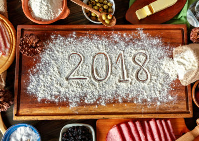 2018 new year's eve sign with Venezuelan Christmas food ingredients for jam bread or pan de jamon over cutting board